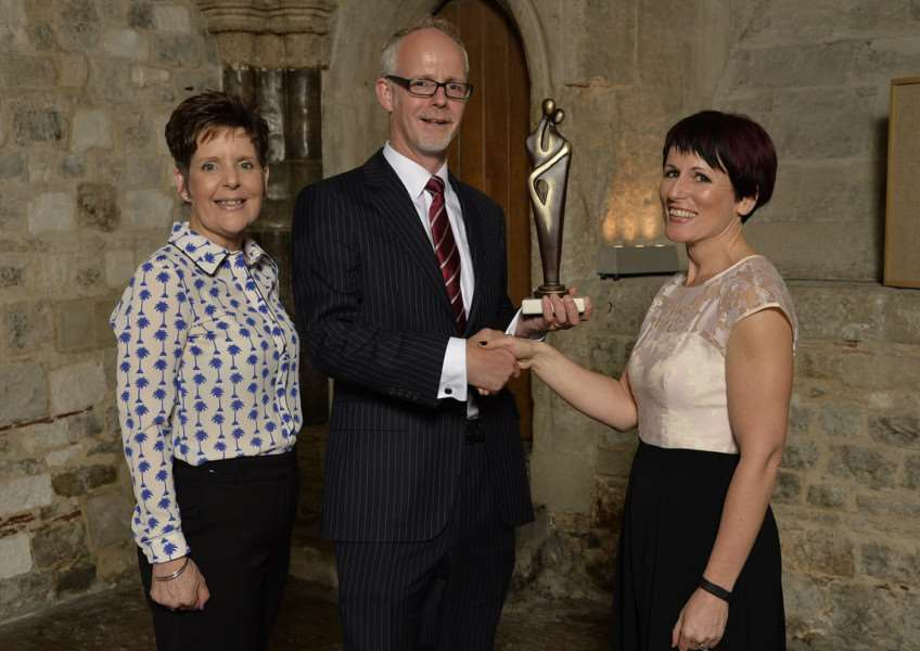 Jan Bloomfield, left, WSH executive director of workforce and communications, and chief executive Steve Dunn receiving a Top Hospital Award from Sarah Atkinson, managing director of CHKS ANL-160513-155038001