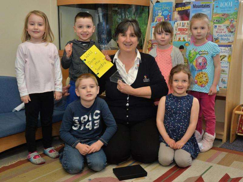 Sandra Copping pictured with some of the youngsters at Newmarkets Colourbox Montessori nursery
