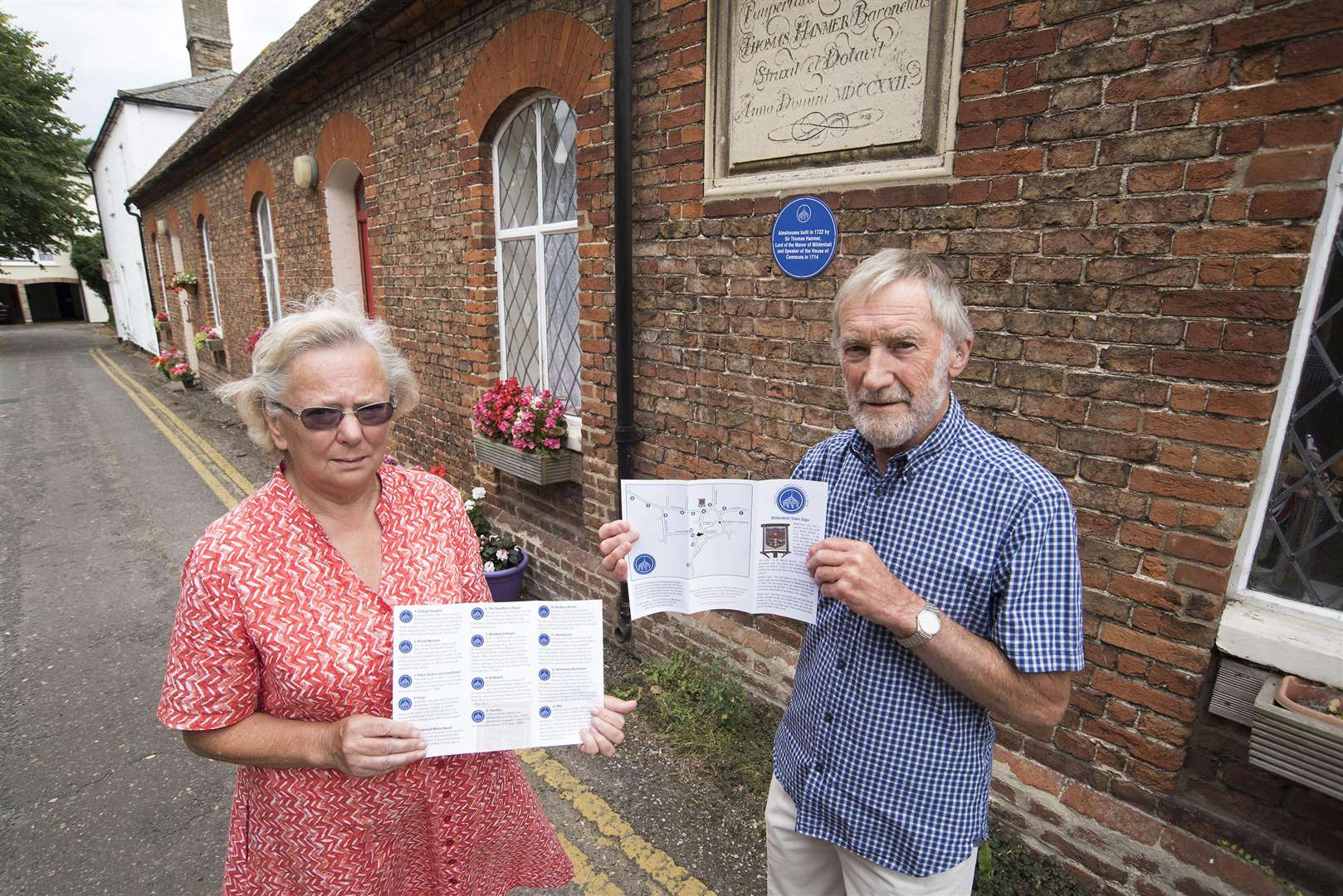 Mike Croughton and Stephanie Palmer from Mildenhall Museum with the plaque on the almshouses built by Sir Thomas Hanmer in 1722. Picture Mark Westley. (3122482)