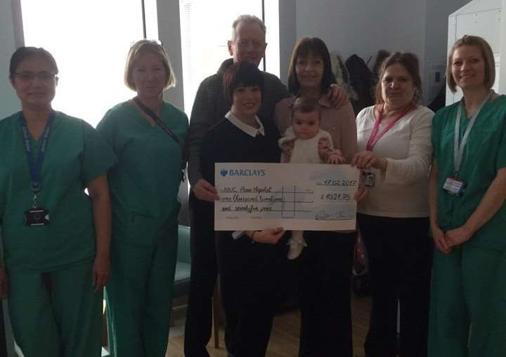 Jan Palmer, Paul Wills, Jodie Palmer and Elodie Savage present a cheque to staff at the NICU at The Rosie maternity unit in Cambridge for �1021.75.