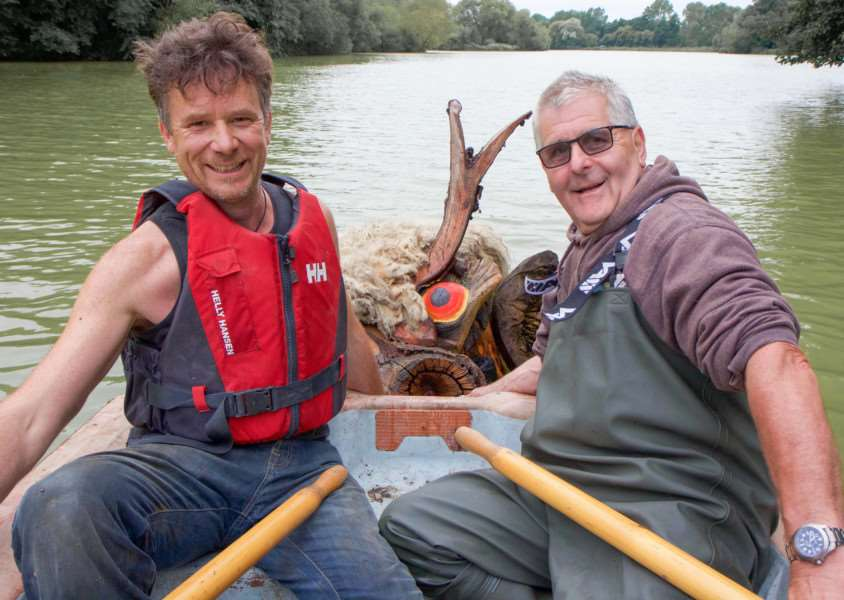 Artist Andy Manning (left) and West Stow Country Park Fisheries Manager, Paul Taylor, tow in Grendel's Mother