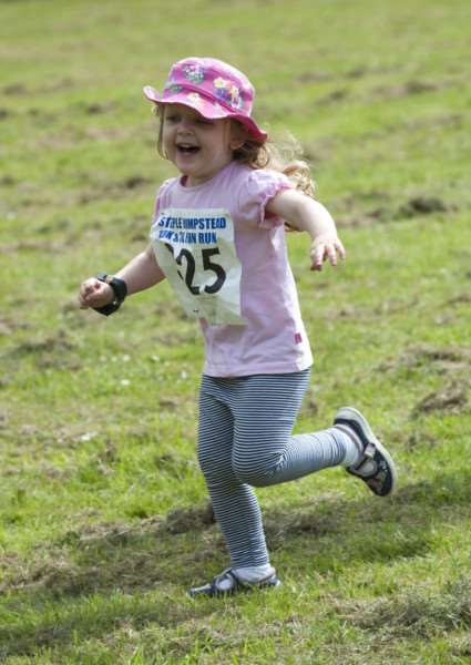Two-year-old Eleanor King beams with joy during her fun run