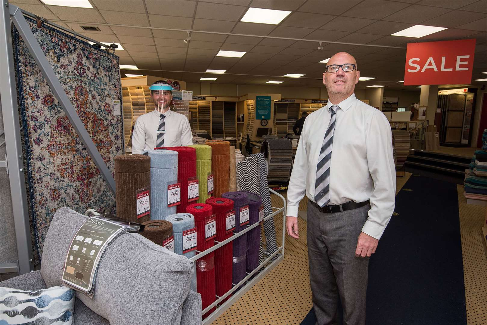 Glasswells sales staff Brian Field and Morrison Horsley at its reopening of its Haverhill store on Saturday. Picture by Mark Westley