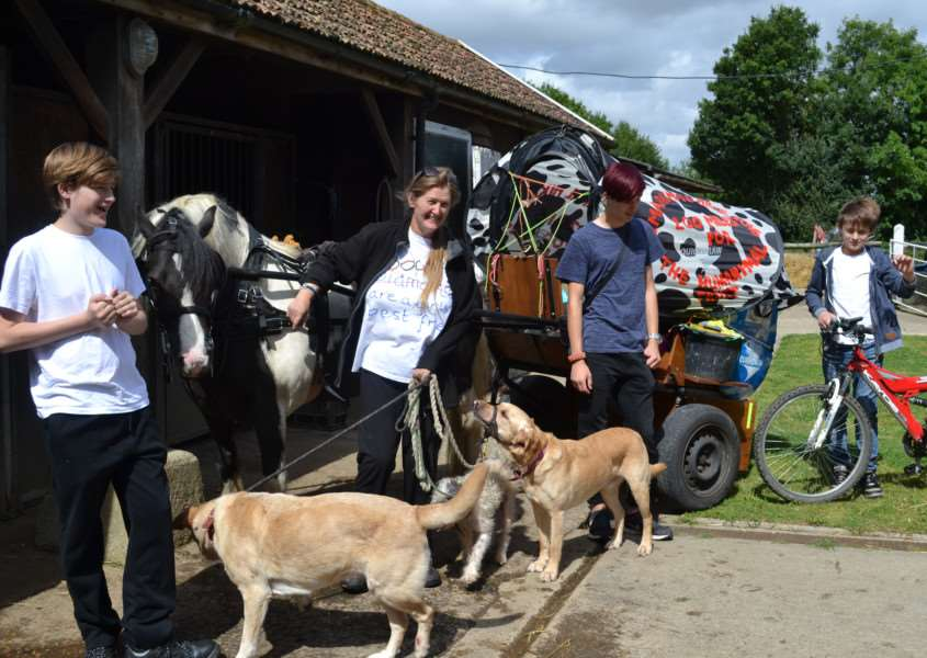 Fenella Harley with her three sons, Thaddeus, Merlin and Jethro, their three dogs and the pony and cart at the start of their 200 mile journey Daughter Keziah is not pictured. ANL-160508-114155001