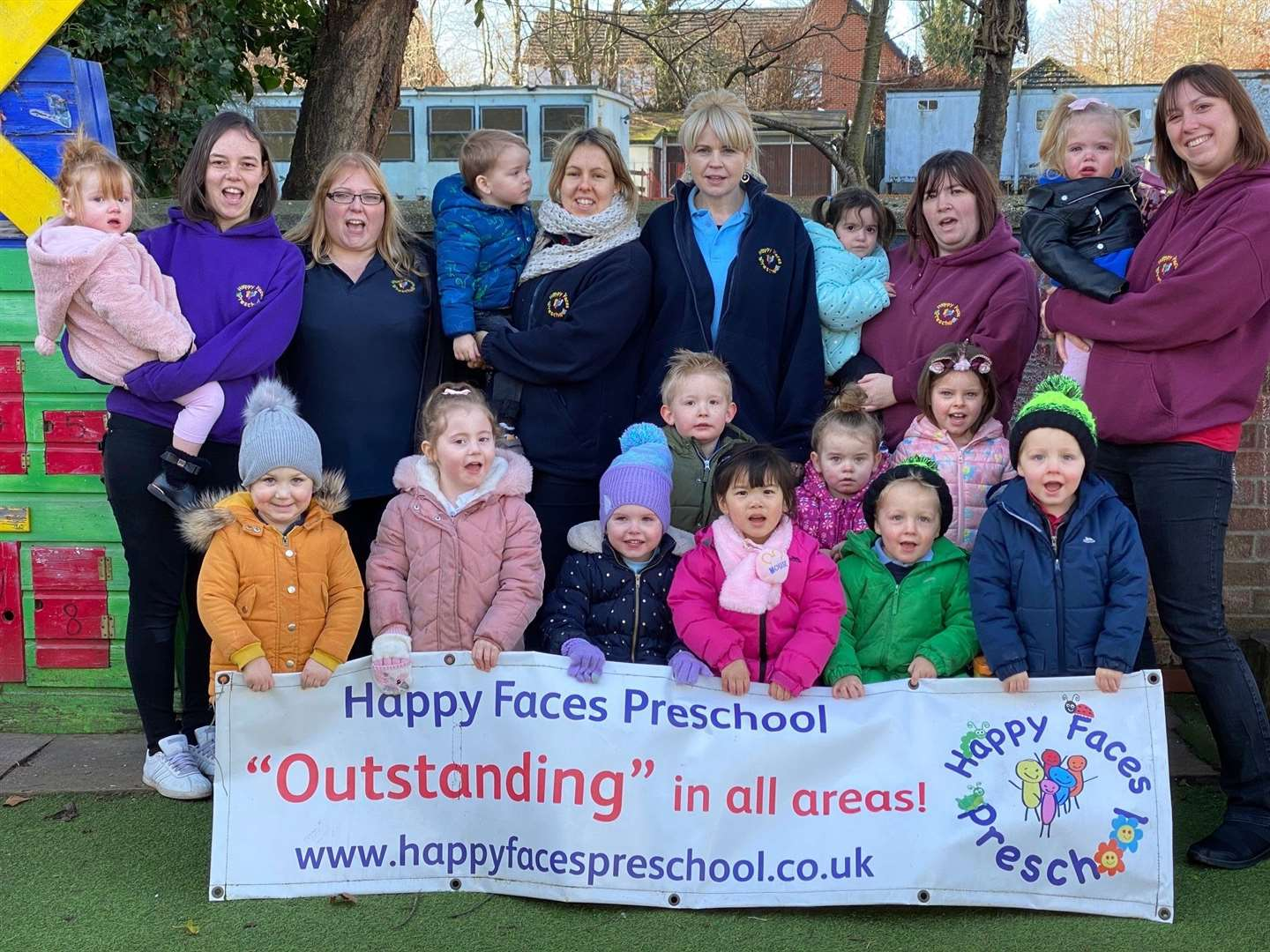The staff and some of the children at Happy Faces Pre-School celebrate its continued high rating by Ofsted inspectors. Contributed picture