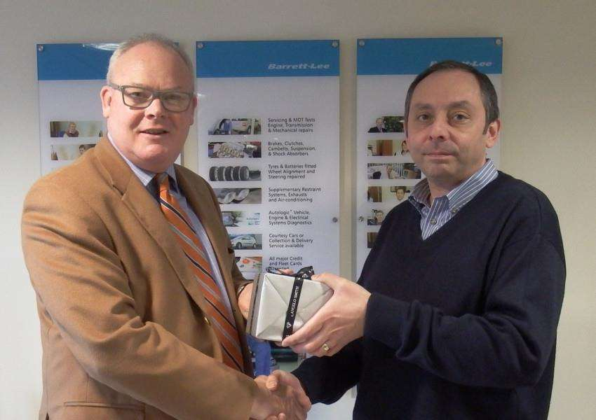 Simon Barrett presenting Adam Beecroft with a gift to mark his 30-year service to the company. ANL-160902-115111001