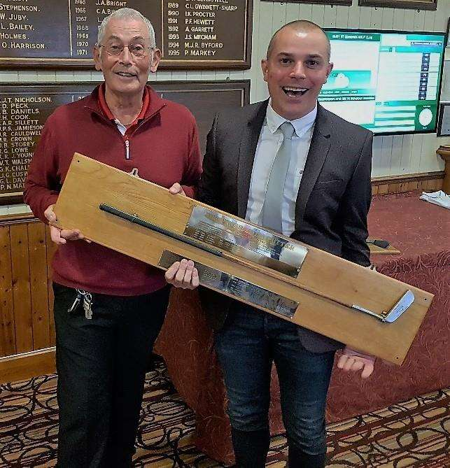 ALL SMILES: Bury St Edmunds Golf Club's Trevor Titcombe receives his prizes for triumphing in the President's Putter competition
