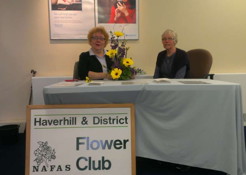 Haverhill & District Flower Club members Valerie Phillips and Irene Godsmark promoting the club at Barclays Bank's Haverhill branch ANL-150105-123936001