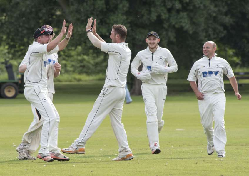 ALMOST THERE: Mildenhall (pictured celebrating a wicket against Witham earlier this season) are closing in on promotion to the East Anglian Premier League