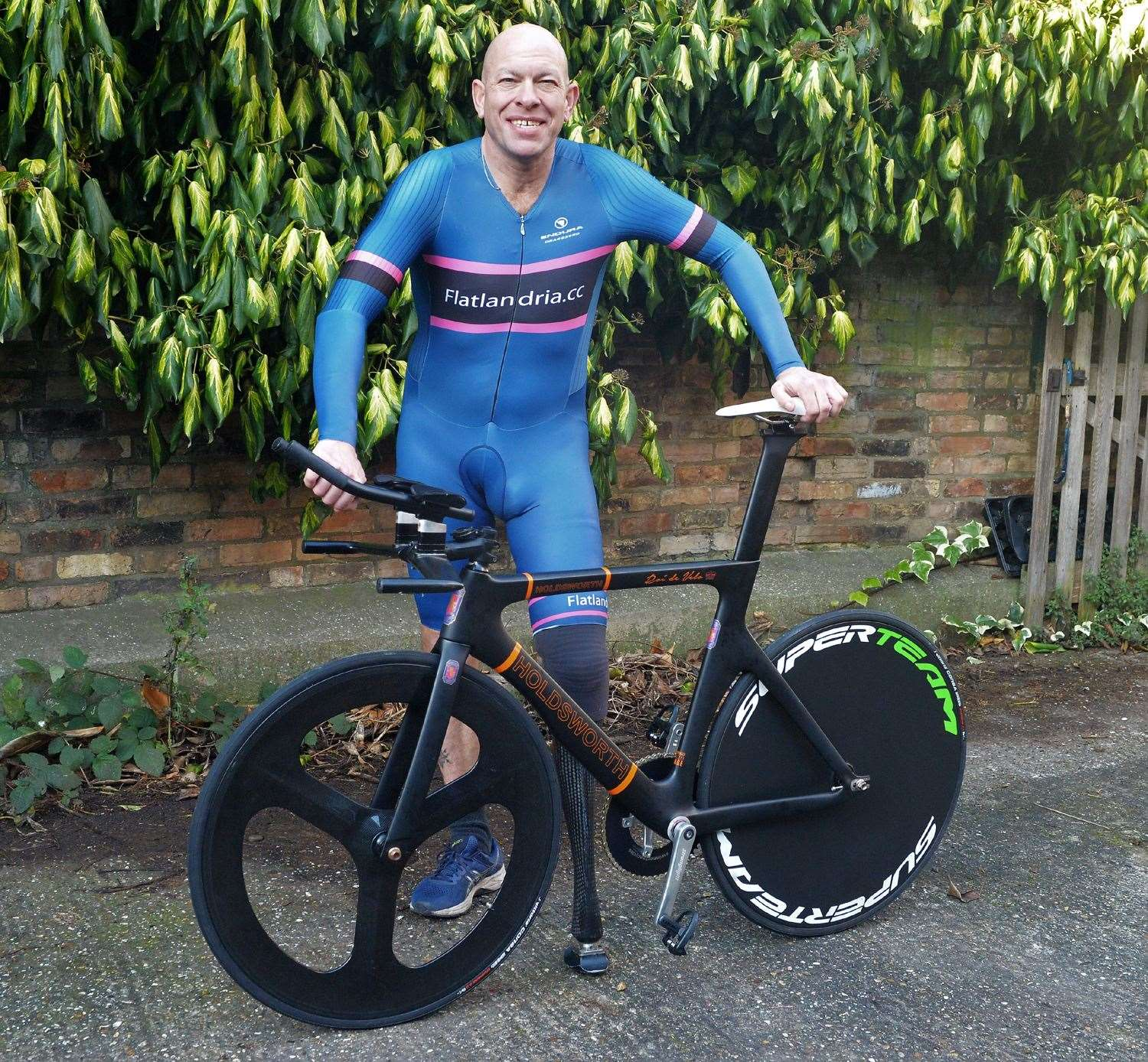Wayne Harrod with the bike on which he set his world record