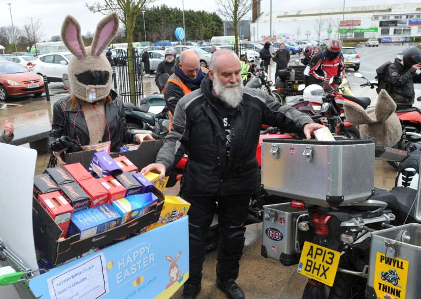 Bury & District MAG (motorcycle action group) held its annual Mad Cow Easter Egg Run today for the children at disability charity Scope in Shakers Lane. ''Pictured: They stopped off at ASDA to pick up the easter eggs. Andy Turner loads up his bike with the eggs before heading to SCOPE ANL-150329-203130009