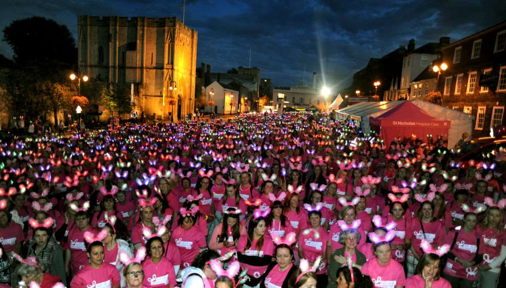 A sea of flashing furry bunny ears as a record breaking gathering of intrepid fund-raising ladies gather for the Girl's Night Out walk for St Nicholas Hospice Care on the Angel Hill in Bury St Edmunds on Saturday night ANL-160514-164147001