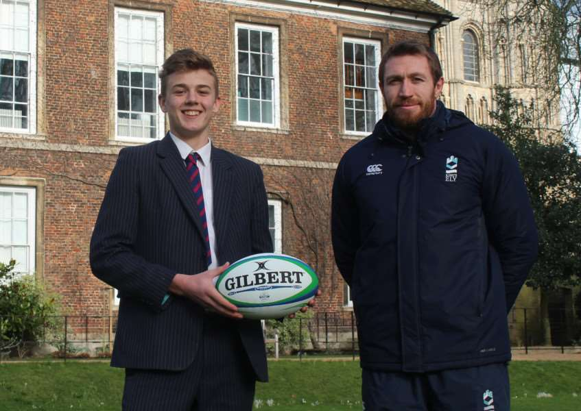 NATIONAL SELECTION: Solomon Boon ' pictured alongside King's Ely's head of rugby Jim Thompson ' has been picked to play for the Lambs Under-16s