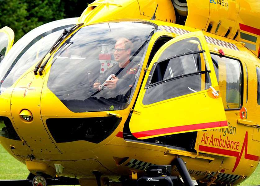 Prince William in his East Anglian Air Ambulance. Photo: SWNS