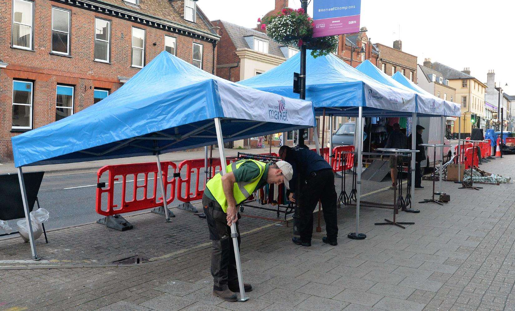 Staff set up new coverings for market traders (4082295)