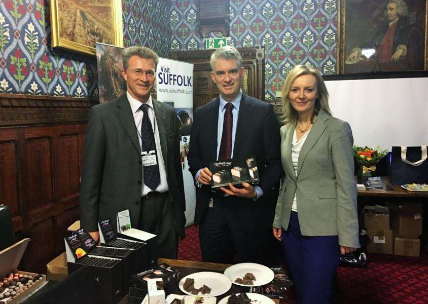 Gavin Bowie of Hadleigh Maid with James Cartlidge MP (centre) and Liz Truss MP.' 'Hadleigh Maid provided lots of different chocolates including truffles, bars and their special Christmas walnut whips. ANL-151125-120509001