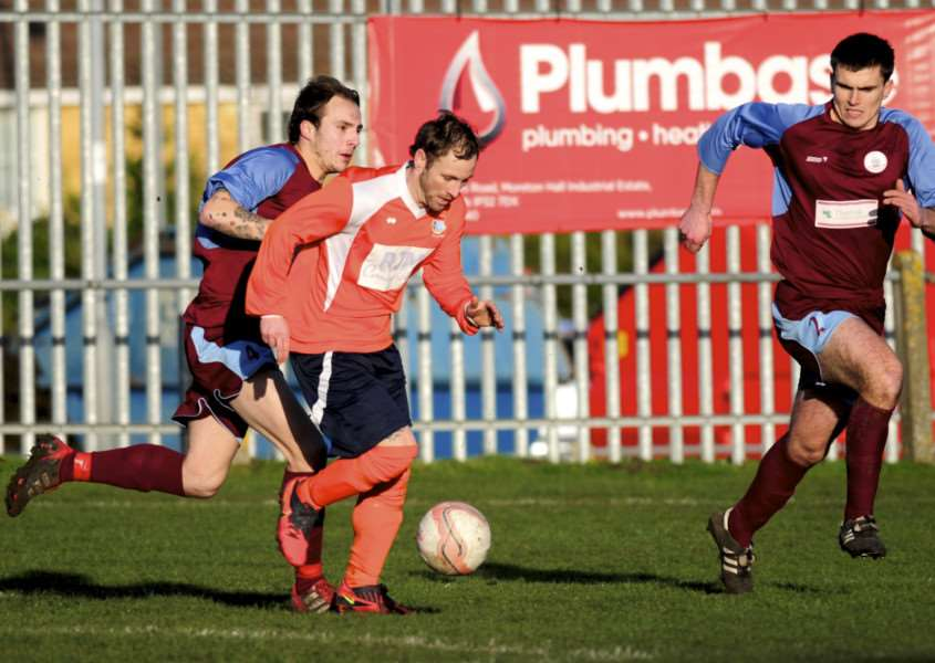 BIG TARGETS: Stow's new signing Matt Dixon, pictured centre playing for his former club Diss Town, wants to get them back into the Premier Division