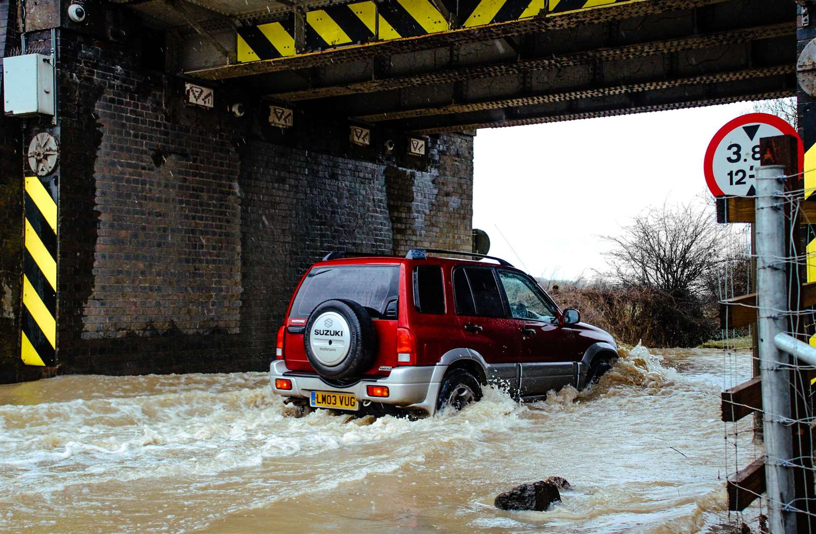 The Met Office has said driving conditions could be difficult, with spray and flooding on roads.