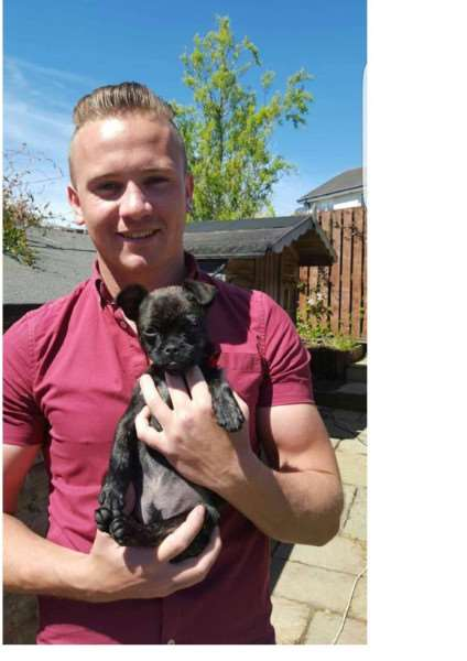 Corrie McKeague with his pug-cross puppy Louell who was left in his room at RAF Honington when he went missing