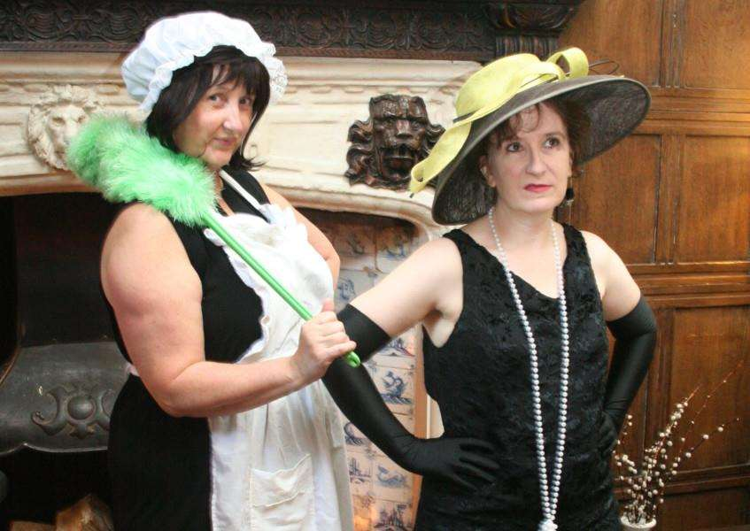 "Tracey Ives as Regine the French Maid and Julia Salmon as Lady Doreen Bishop in Bury Theatre Workshop's play, The Farndale Housing Estate Townswomen's Guild Dramatic Society ""Murder at Checkmate Manor"" ANL-160311-115847001"