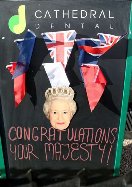 Picture by Richard Marsham'Local businesses show their support in Bury St Edmunds to mark the Queen becoming the longest serving monarch. ANL-150909-165807009