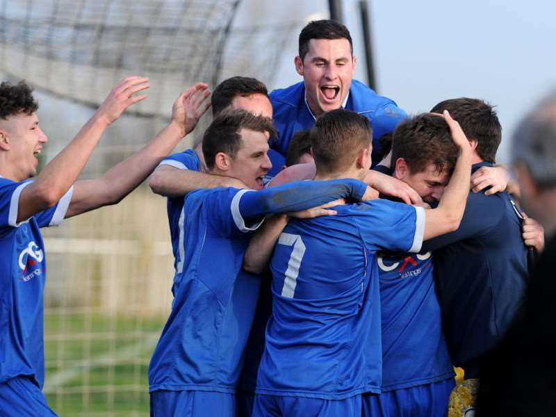 CELEBRATION TIME: Haverhill Borough players celebrate Ryan Swallow's decisive second goal at Woodbridge Town to put his side into a 3-1 lead in their Suffolk FA Senior Cup quarter-final tie. Picture: Mecha Morton