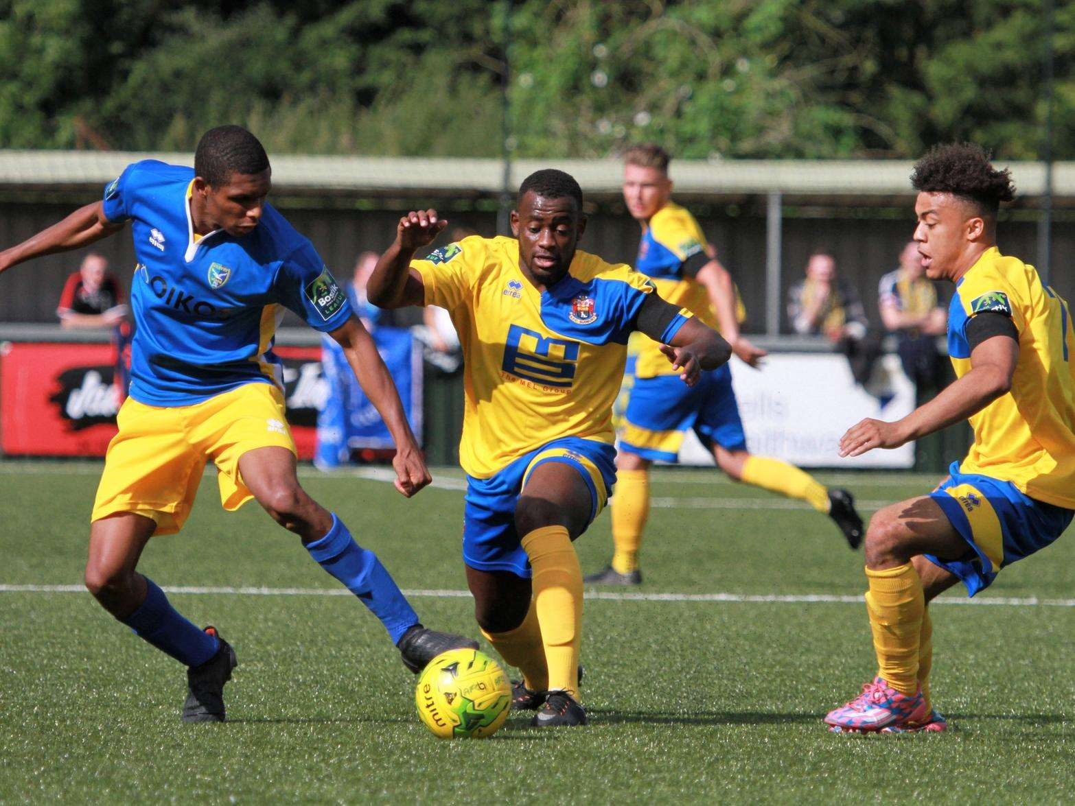 DEBUTANT:One of AFC Sudbury's most recent new signings Jeremiah Kamanzi, centre, in action against Canvey Island on Saturday Picture: Clive Pearson