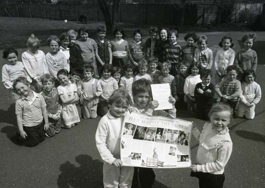 This photo shows children at Chedburgh Primary School in May 1986, accepting a thank you letter from the Queen.
