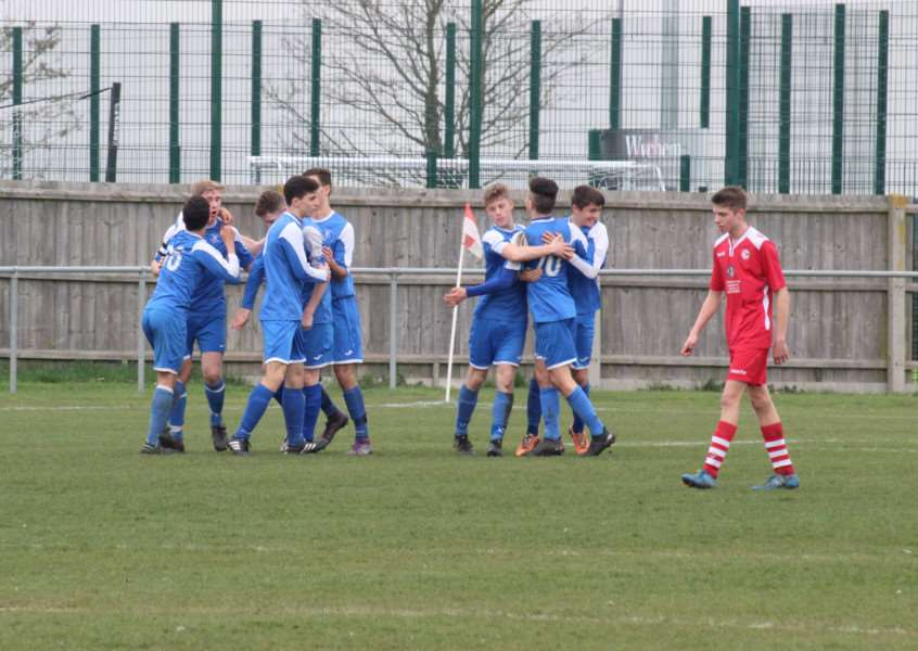 ON TARGET: Bury Under-16s celebrate one of their two goals against Haverhill