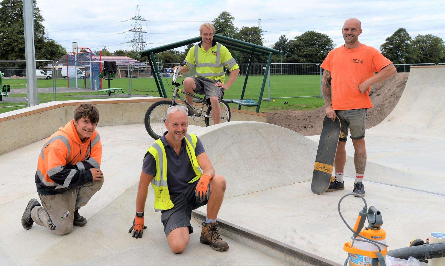 Members of the building team are putting the finishing touches to Burwell's new skatepark.