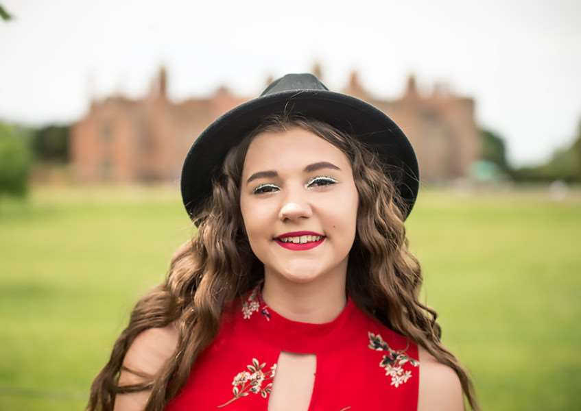 Gabby Rivers in front of Melford Hall. Photo by Allison Burke Photography.
