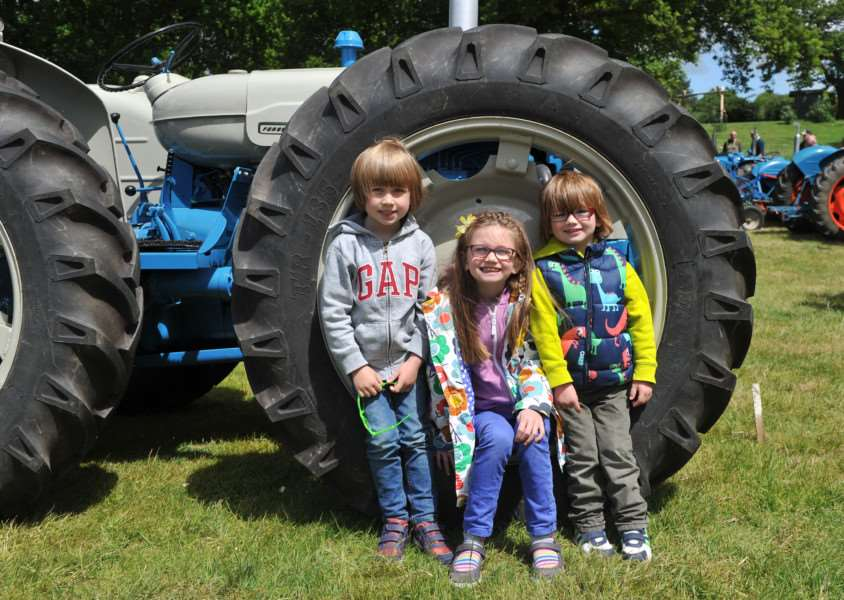 Woolpit Steam 2015''Pictured: Monty (5), Felicity (6) and Rufus (3) Johnson enjoying their day out on the classic tractor display ANL-150531-121206009