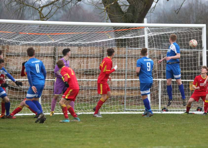 OPENING GOAL: Cornard United's Ezra Drann heads his side in front in their 2-0 home win over Needham Market Reserves