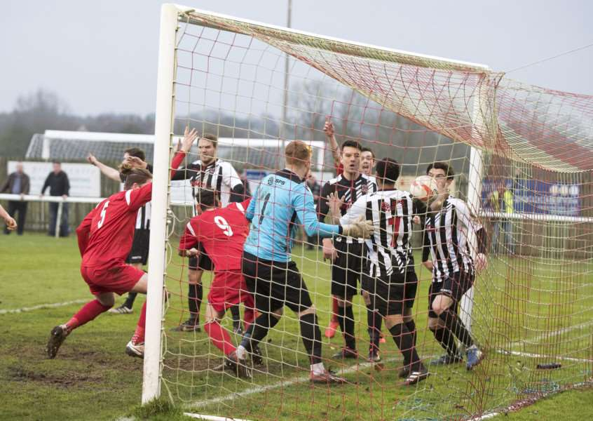 DEADLOCK BROKEN: Ashley Shipp (nine) wheels away to celebrate the tie's opening goal