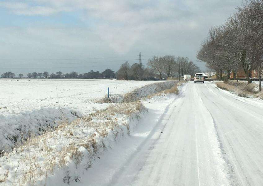The snow-covered road between Barningham and Bardwell pictured by Ashley Smart