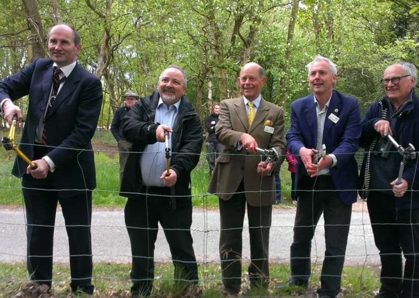 Ceremonial cutting of the fence at Knettishall Heath. From left to right: William Kendall, the High Sheriff of Suffolk; Peter Cox, Managing Director of WREN; Ian Brown, Chairman of Trustees at Suffolk Wildlife Trust; Julian Roughton, Chief Executive of Suffolk Widlife Trust; and Phil Rothwell, of the Heritage Lottery Fund.