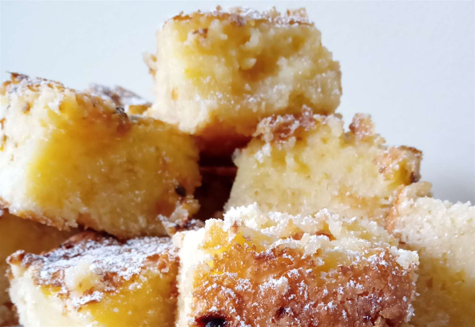 Culture: After the year we have all lived through, food writer Nicola Miller says we should seek out pleasure, and delivers a large slice of pure hedonism with her recipe for a gooey butter cake