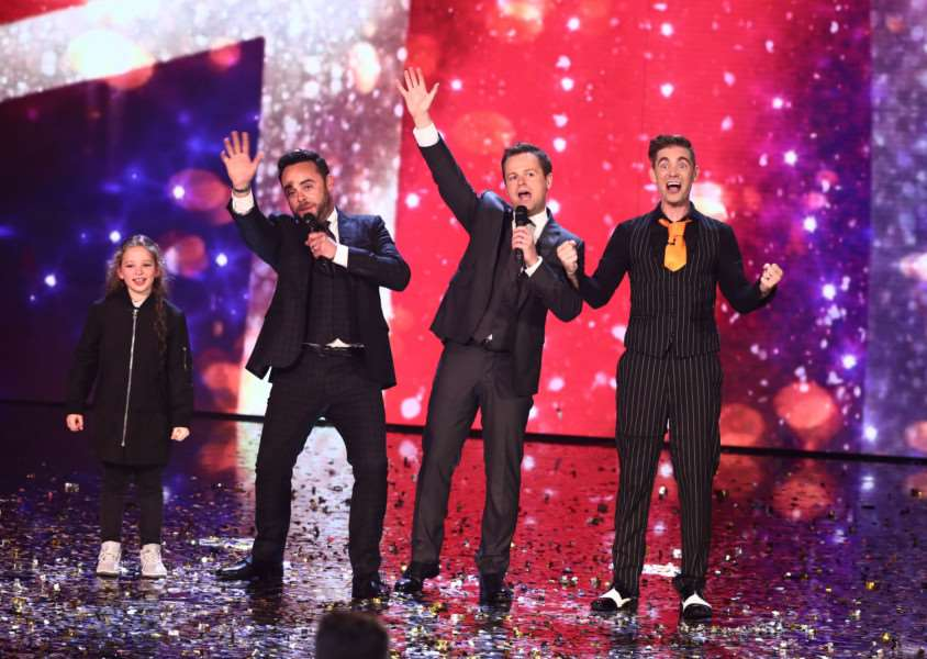 Matt Edwards, right, celebrates his place in the BGT final alongside fellow magician Issy Simpson. Picture: Splash News.