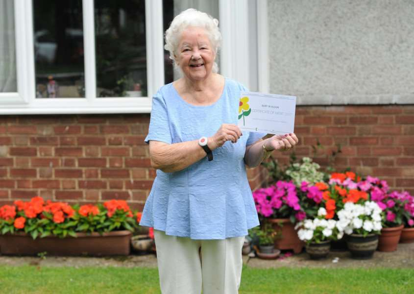 Faith Naylor is 92 but still does her front garden floral display herself and has just received her fourth Bury in Bloom Award. '''''PICTURE: Mecha Morton
