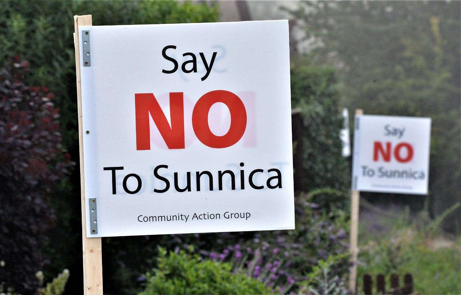 Protest placards have appeared in gardens all over Freckenham