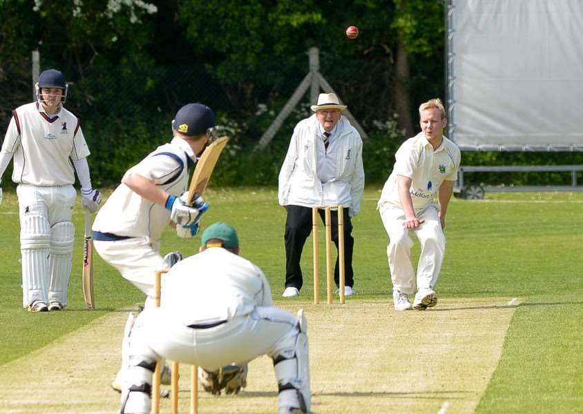 Long Melford's Tom Barnard bowls to Haverhill's Dan Pass during their match at Manor Road.