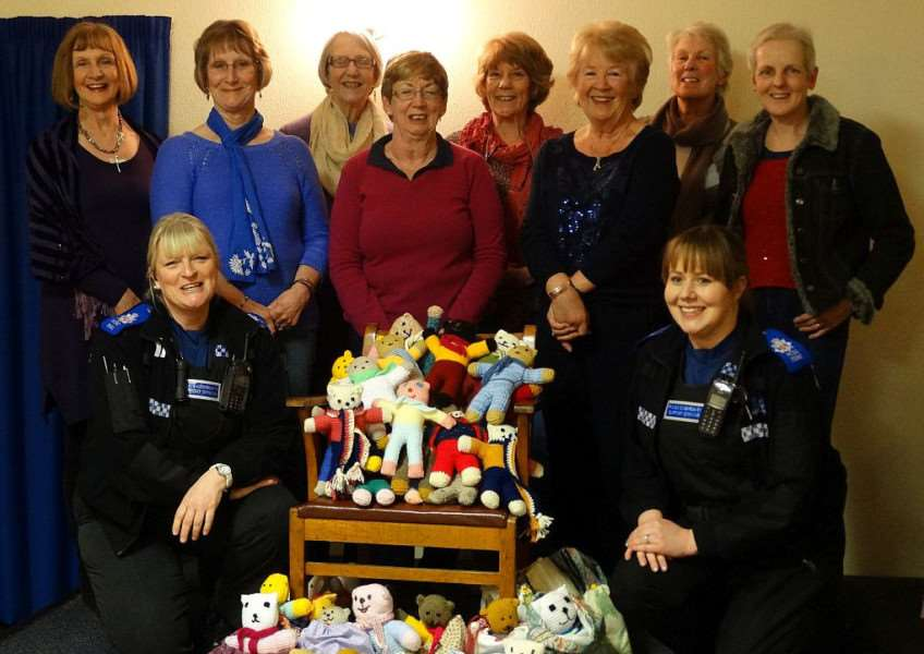 Members of the Earls Colne WI knitted 61 trauma teddies for Essex Police. ANL-150204-134330001