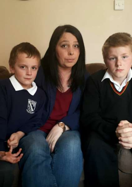 Paula Hill with sons Jacob, 6, left, and Mason, 12, right