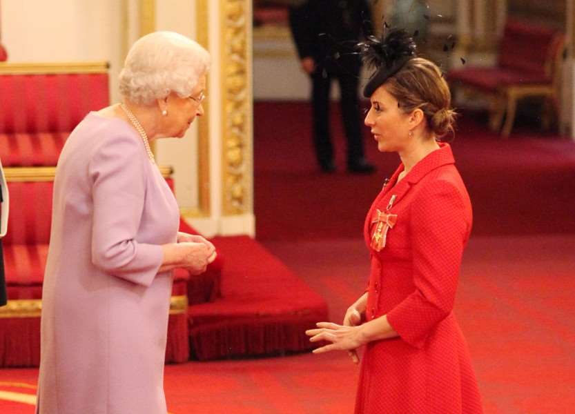 Hayley Turner from Newmarket is made an Officer of the Order of the British Empire (OBE) for services to horseracing by Queen Elizabeth II at Buckingham Palace in London. PRESS ASSOCIATION Photo. Picture date: Tuesday October 25, 2016. See PA story ROYAL Investiture. Photo credit should read: Jonathan Brady/PA Wire ROYAL_Investiture_125829.JPG