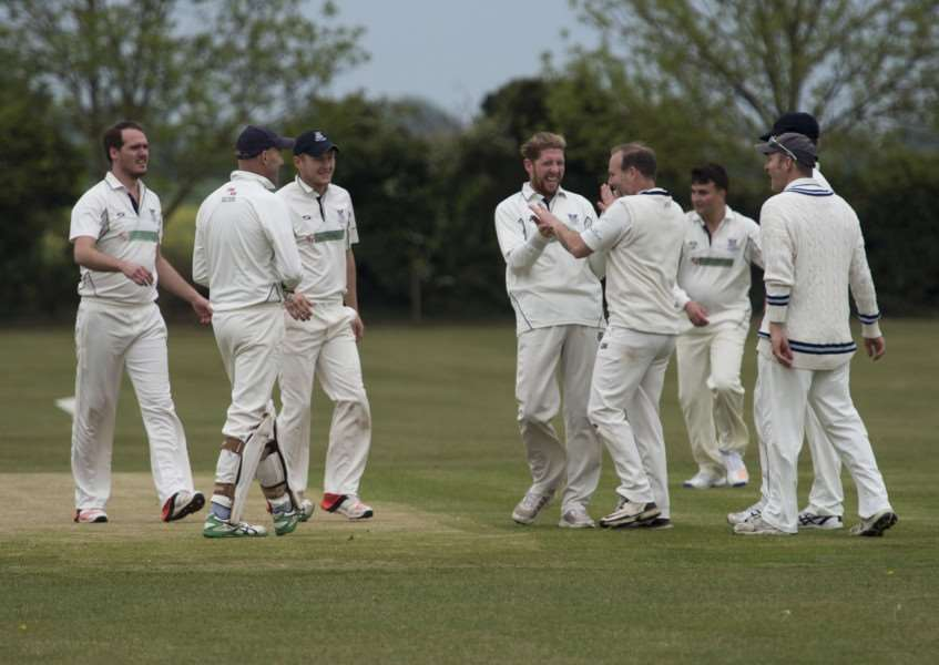 GET OUT: The Fordham players celebrate the dismissal of another visiting batsman