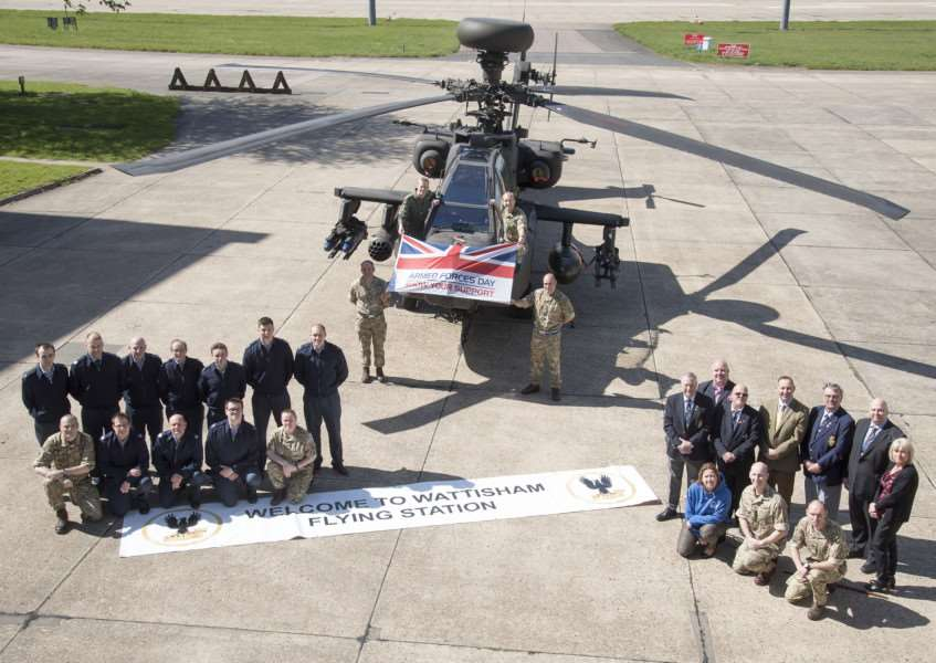 Armed Forces Day 2016 organising committee with councillors'and an Apache attack helicopter ANL-160420-191928009