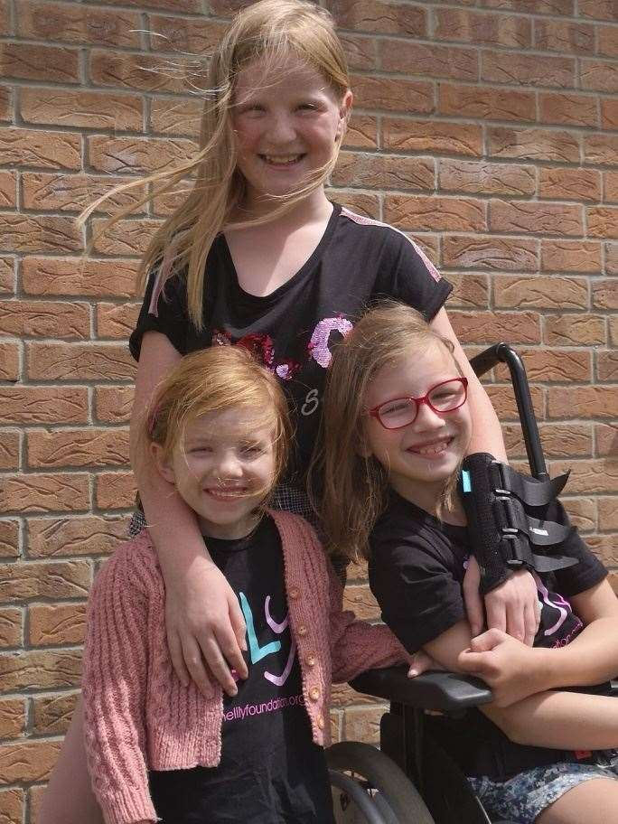 Chloe Hoddinott, rear, with sisters Lily (left) and Willow Bamber. Contributed picture