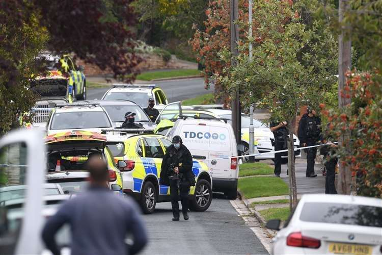 Armed police officers outside a property in Westwood Avenue, Ipswich (Joe Giddens/PA)
