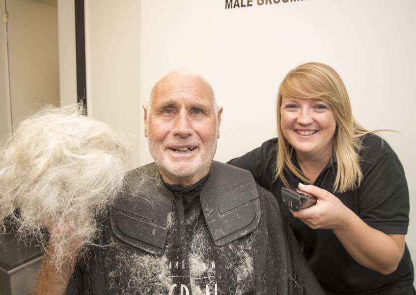 Charity hair and beard shave for Michael Howard at Medleys in North Street Sudbury, Odette Medley with the clippers helped by her brother and shop owner Sonny, 'Picture Mark Westley ANL-160830-170430009