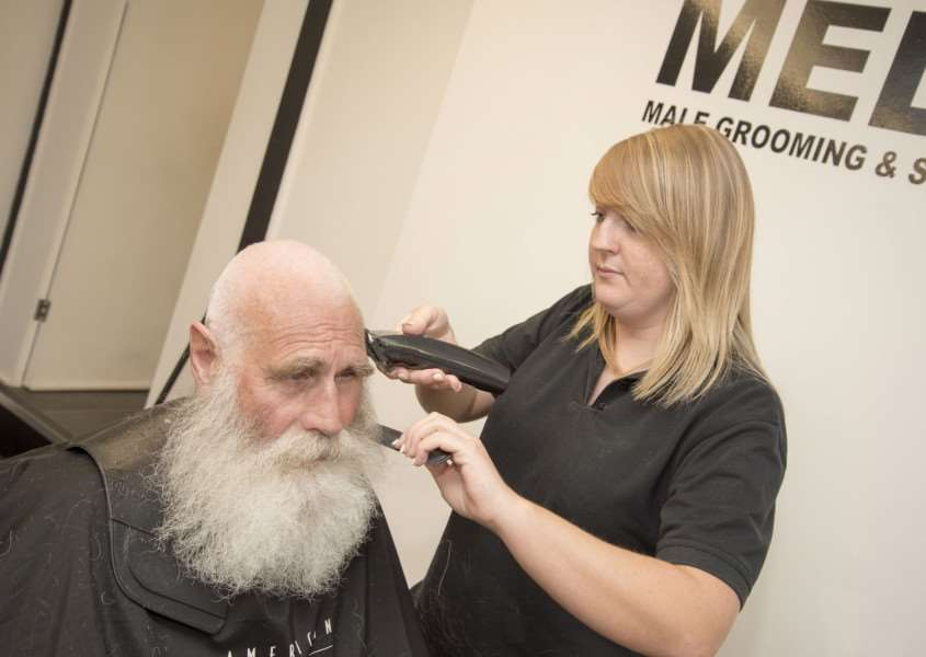 Charity hair and beard shave for Michael Howard at Medleys in North Street Sudbury, Odette Medley with the clippers helped by her brother and shop owner Sonny, 'Picture Mark Westley ANL-160830-170325009